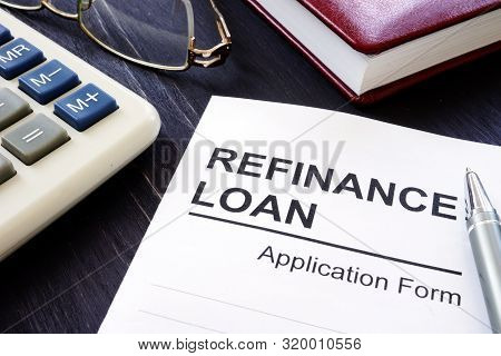 Refinance Loan Application Form And Pen With Calculator.