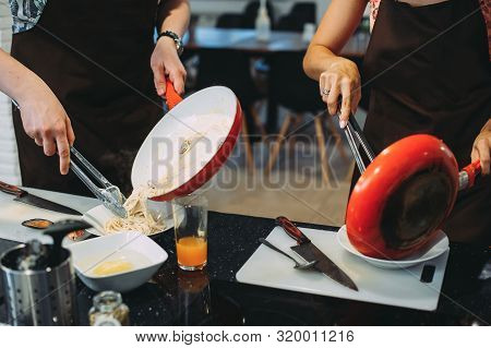 Culinary Master Class For Cooking Pasta With Mussels. Close-up Of Hands