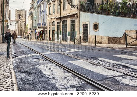 1 March 2018: Lisbon Portugal - Road With Tram Track In Poor Condition In The Alfama District. Lisbo