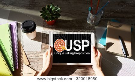 USP - Unique selling propositions. Business and finance concept on device screen. poster