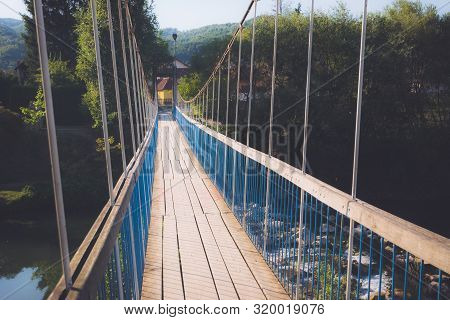 Old Blue Bridge. Travel Photography Of Old Bridge. Crossing Old Wooden Bridge. Old Wooden Bridge. Tr