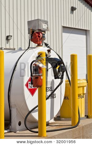 Environmentally safe industrial fuel tanks with safety features such as fire extinguishers and back up pillars to prevent trucks from backing into the tanks.