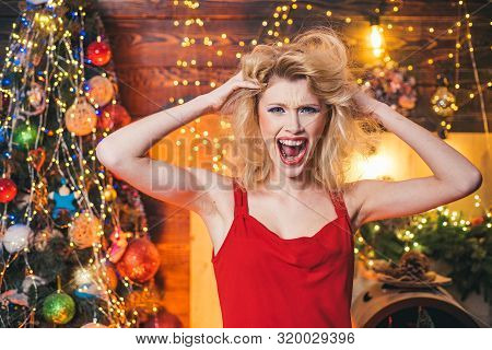 Merry Christmas and happy new year. Crazy woman. Nervous, thrilled and scared emotions. Crazy comical face. Comic grimace poster