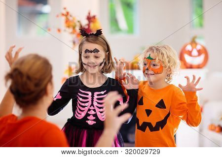 Child And Mother In Halloween Costume. Kids Trick Or Treat. Face Painting For Party Event. Little Bo