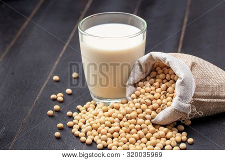 Soy Milk And Soybean On Dark Wooden Background