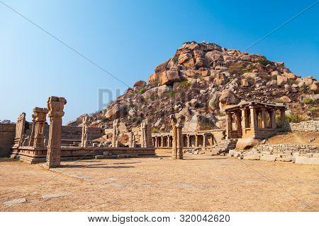 Mountain With Boulders And River At Hampi, The Centre Of The Hindu Vijayanagara Empire In Karnataka
