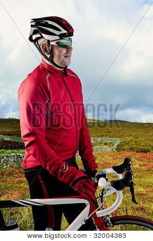 Cyclist And His Bike
