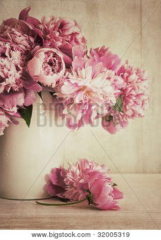 Pink peonies in vase with vintage look