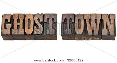 ghost town - isolated phrase in vintage letterpress wood type, French Clarendon font popular in western movies and memorabilia