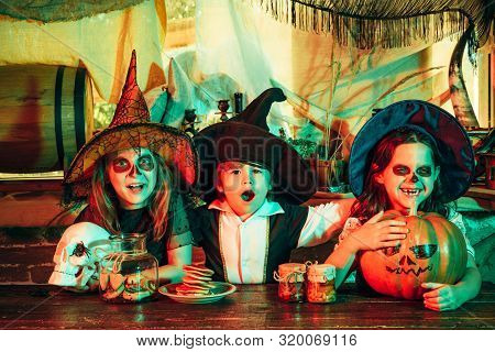 Surprised Group Little Zombie In Halloween Costume Eating Treat - Calaverita Sweets Candles. Funny H