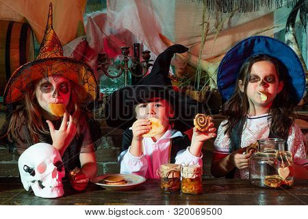 Funny Group Of Friends Kids In A Halloween Costume On Halloween Party. Halloween Kids Holidays Conce