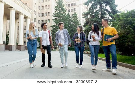 University Life. Happy Students Walking In Campus And Talking, Having Break After Classes
