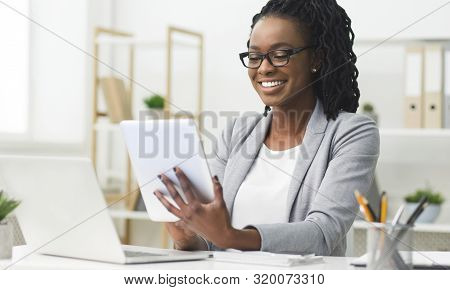 Business App. Afro Woman Using Tablet And Laptop Computer In Office. Free Space For Text