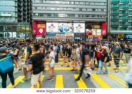 Hong Kong, Hong Kong - July 2019 : Crowd Unrecognizable Protester Walking Around Tsim Sha Tsui Stree