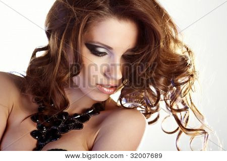 beautiful young woman portrait with long hair in motion, studio shot