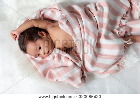 Cute Asian Newborn Baby Just Wake Up In The Morning With Cozy Bed. Adorable Newborn Asian Baby Stret
