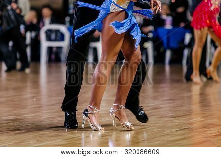 feet dancers couple man and woman dancing latino program poster