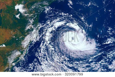 Category 5 Super Typhoon Approaching The Coast. The Eye Of The Hurricane. View From Outer Space  Som
