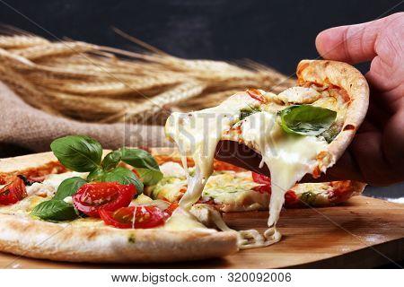 Vegetarian Italian Pizza With Tomatoes, Mozzarella Cheese  And Basil. Delicious Italian Pizza