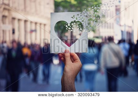 Health And Wellbeing Global Issue As Human Hand Holding A Paper With Heart Symbol Breaking Into Piec