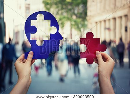 Two Hands Holding A Paper With Human Head And A Puzzle Piece. Finding A Cure To Heal The Disease. Me