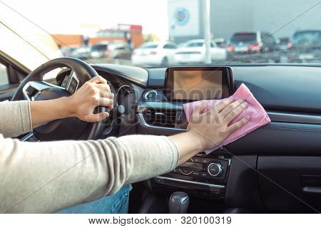 Close-up, Hand Wipes Dust With Pink Cloth, Inside Car, Clean And Care For Inside Of The Car, In The