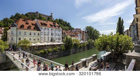 Ljubljana, Slovenia - August 15, 2019: View Of The Embankment Of The Ljubljana River In Ljubljana