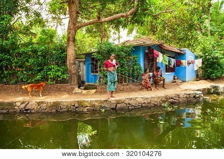 Alappuzha, India - March 19, 2012: Unidentified Old Local Woman Fishing In Alappuzha Backwaters In K