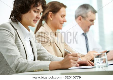 Business group of three being concentrated on their work