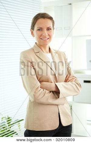Smiling business woman looking at camera