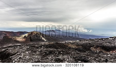 Volcanic Landscape. Lava Plains From Layer Of Solid Lava, Kamchatka Peninsula, Russia