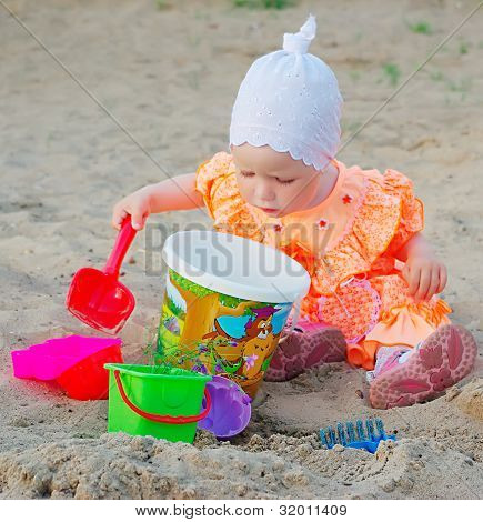 Child In Sand Box