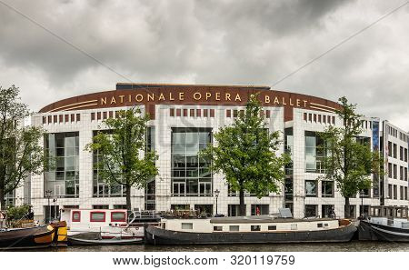 Amsterdam, The Netherlands - July 1, 2019: Large White Building With Brown Crown Of National Opera A