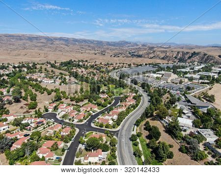 Aerial View Of Small Neighborhood With Dry Desert Mountain On The Background In Moorpark, Ventura Co