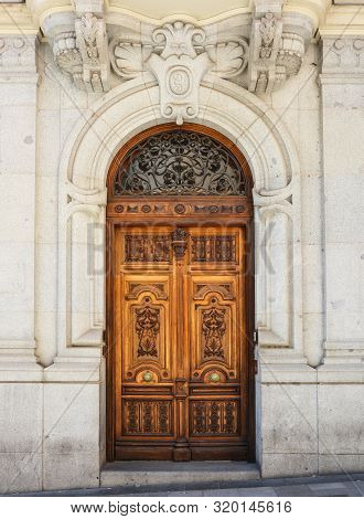 Old Wooden Entrance Door In Madrid, Spain