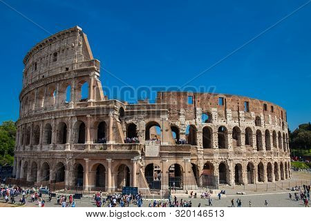 Rome, Italy - April, 2018: Tourists Visiting The Famous Colosseum In Rome In A Beautiful Early Sprin