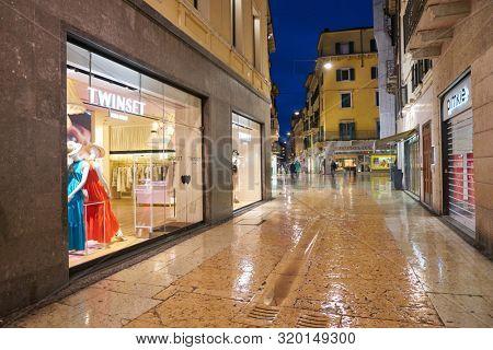 VERONA, ITALY - CIRCA MAY, 2019: a street with shops in Verona.