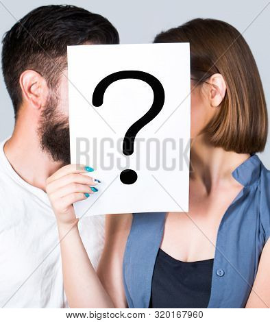 Problem In Couple, Question Mark. Couple Holding Paper Question Mark. Anonymous, Man And Woman Quest