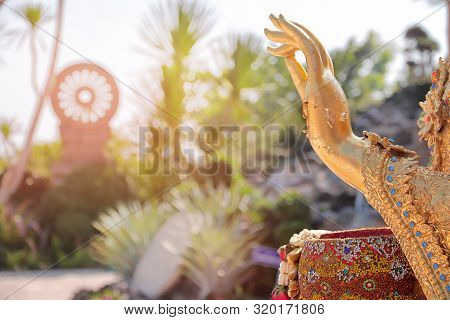 Palm Of Left Hand And The Right Hand Hold  Colorful Bowl Of The Outdoor Buddha Statue.  And Free Spa