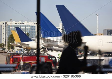 Airport Runaway Traffic With Aeroplanes And Cargo Vehicles. Busy Terminal
