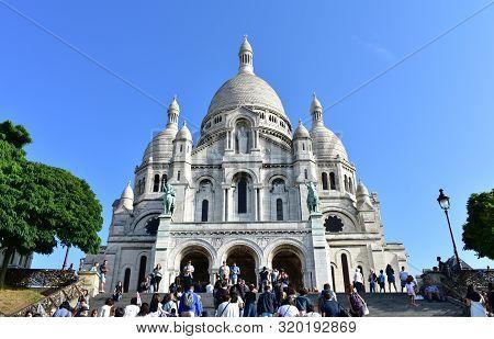 Paris, France. August 12, 2019. Basilique Du Sacre Coeur With Tourists And Blue Sky.