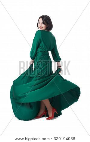 Woman In Beauty Fashion Style, Pretty Girl Dancing In Long Green Evening Dress, Happy And Smiling, T