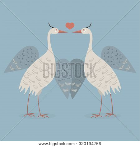 Two Herons With Spread Wings Are On A Blue Background.