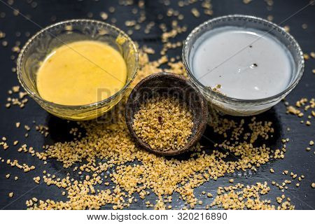 Curd Or Yogurt And Oats Face Mask On The Woodne Surface In A Glass Bowl Along With Some Raw Oats In