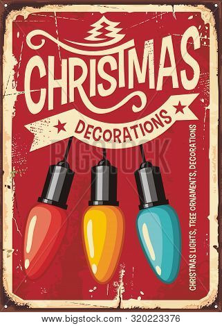 Christmas Decorations Store Vintage Metal Sign With Colorful Lights On Red Background. Retro Holiday