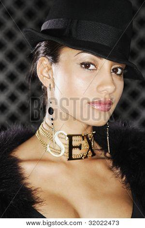 Portrait of Hispanic woman wearing SEX necklace