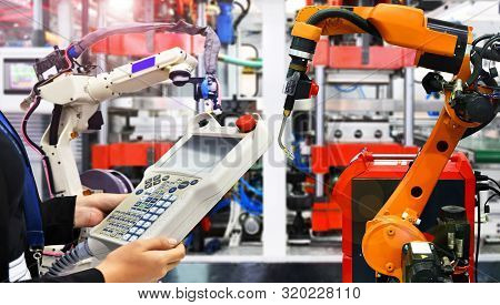 Engineer Check And Control Modern High Quality Automation Welding Robots Arm At Industrial