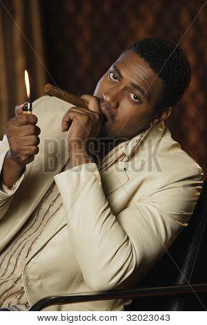 Portrait of African man lighting cigar