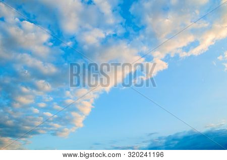 Sunset dramatic sky background - picturesque colorful sky clouds lit by sunlight. Vast sky landscape panoramic scene, colorful sky view in soft tones