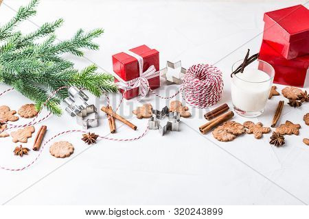 Homemade Delicious Christmas Gingerbread Cookies With Glass Of Milk, Spices, Cinnamon And Anise Star